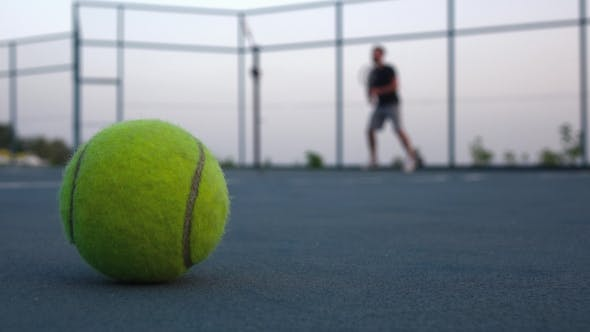 Thumbnail for Tennis Ball On The Court. People Are Playing Tennis Outdoors
