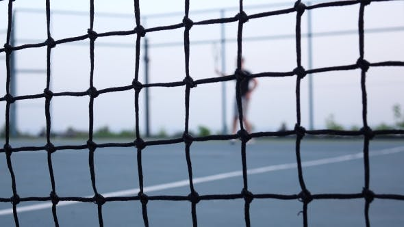 Thumbnail for Tennis Player Volleys Using Forehand Technique. Tennis Net In Front