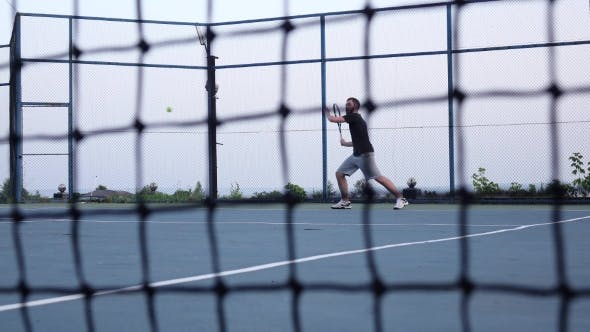 Thumbnail for Tennis Net. Men Playing Tennis In The Background