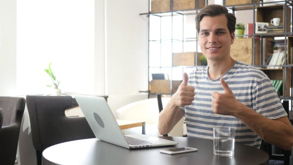 Cover Image for Both Hands Thumbs Up by Creative Man at his Workplace