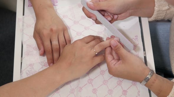 Thumbnail for Woman In a Nail Salon Receiving a Manicure By a Beautician