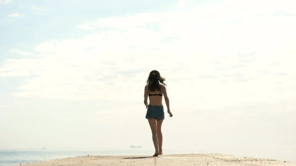 Thumbnail for Girl Jumping On The Pier At The Sea