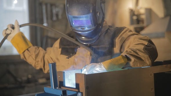 Thumbnail for Worker With Protective Mask Welding Metal