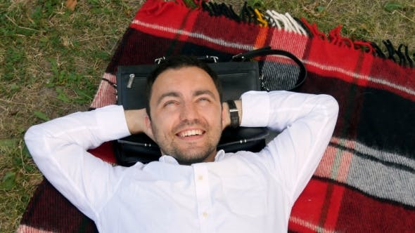 Thumbnail for Attractive Man Is Lying In The Park