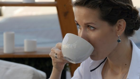 Thumbnail for Beautiful Woman Drinking Coffee