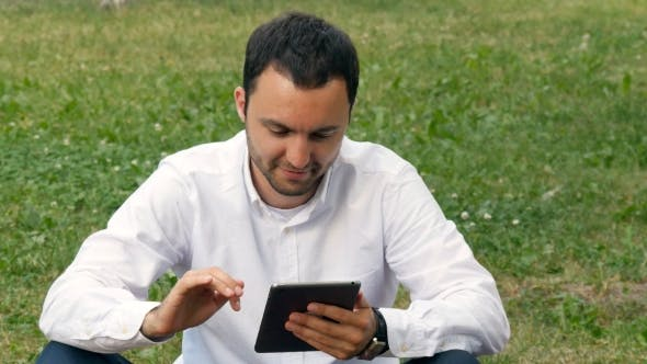 Thumbnail for Businessman Working Outdoors With Digital Tablet PC At The Park. Relaxing With a Digital Tablet