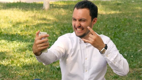 Thumbnail for Young Business Man Taking Selfie Pictures On a Mobile Phone, Summer Park Outdoors