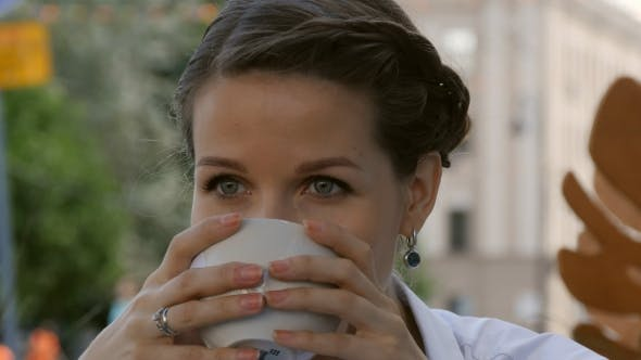Thumbnail for Young Beautiful Woman Holding Cup of Coffee at Bar