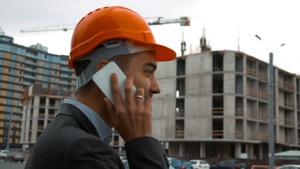 Thumbnail for Builder In a Orange Helmet Is Making Call