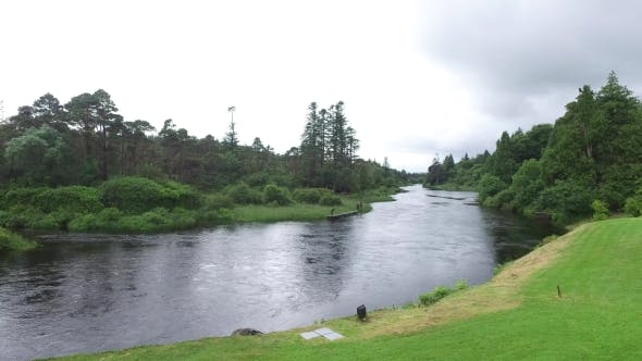 Thumbnail for Men Fishing On River Bank In Ireland Valley 6