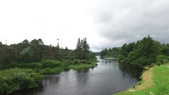 Thumbnail for Men Fishing On River Bank In Ireland Valley 2