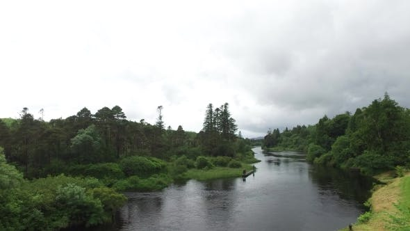 Thumbnail for Men Fishing On River Bank In Ireland Valley 1