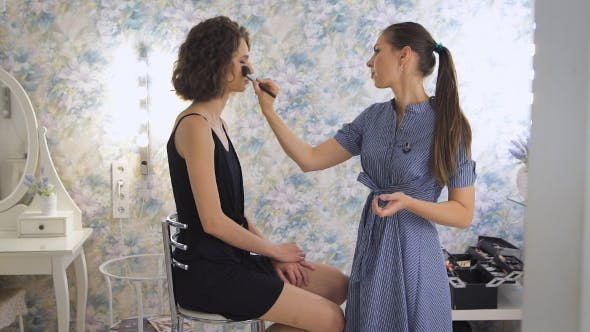 Thumbnail for Young Female Make-up Artist Working In The Bright Studio, Applying Makeup On a Client