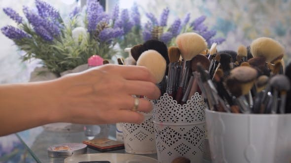 Makeup Brushes, Next To Blue Flowers, .
