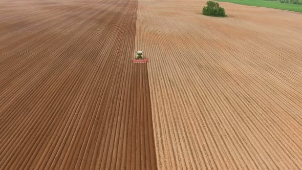 Thumbnail for Farmer Seeding, Sowing Crops At field.Aerial View.