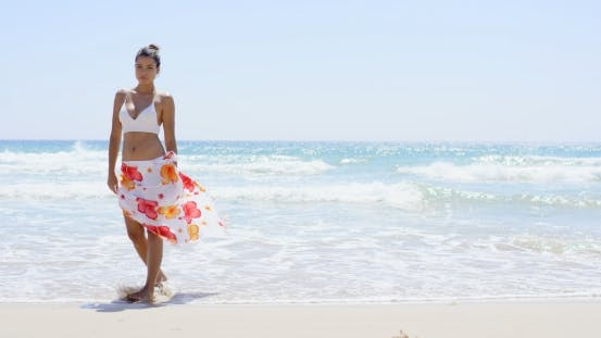 Thumbnail for Gorgeous Young Woman Walking Along a Beach