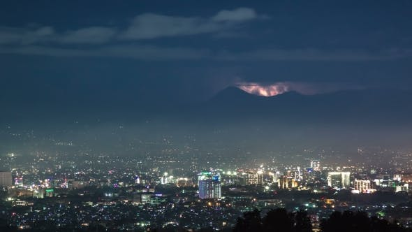 Thumbnail for Night City Aerial View And On The Horizon The Lightning In The Mountains