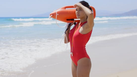 Thumbnail for Pretty Brown Haired Life Guard Stares At Camera