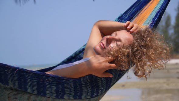Thumbnail for Beautiful Woman Resting In Hammock At Beach On Vacation
