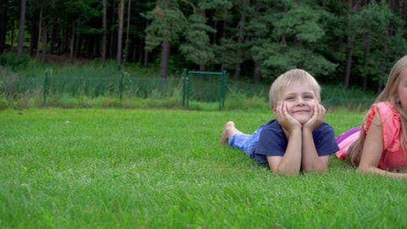 Thumbnail for Children Playing On The Grass