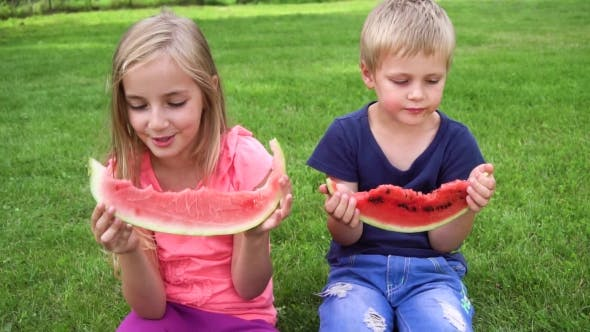 Thumbnail for Kids Eating Watermelon Outdoors