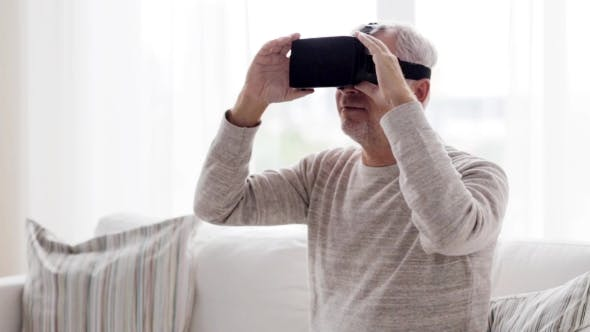 Thumbnail for Old Man In Virtual Reality Headset At Home 79