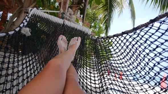 Thumbnail for Woman Legs Swinging In Hammock On Beach. .