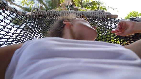 Thumbnail for Sexy Girl Relaxing In Hammock On Beach In Summer Holiday