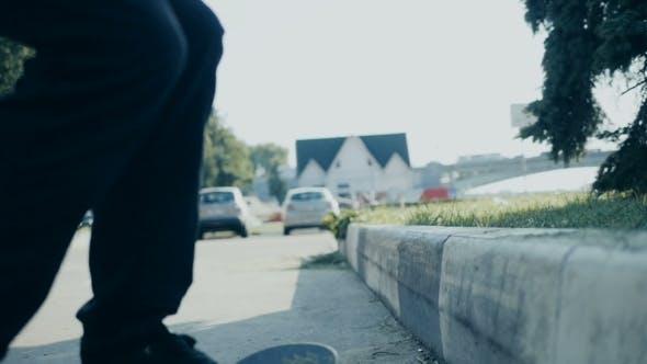 Thumbnail for Skateboarder Doing a Skateboard Tail Board Slide Over The Rail At The Skate Park.