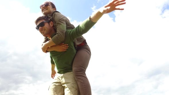 Cover Image for Happy Couple Having Fun Outdoors 11