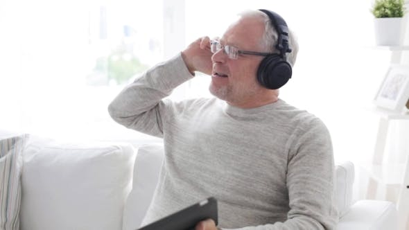 Thumbnail for Senior Man In Headphones With Tablet Pc At Home 15