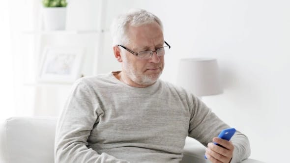 Thumbnail for Happy Senior Man Calling On Smartphone At Home 97