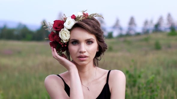 Thumbnail for Beautiful Girl In The Black Short Dress With The Wreath On Her Head On The Green Field.