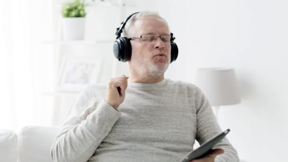 Thumbnail for Old Man  In Headphones With Tablet Pc At Home 90