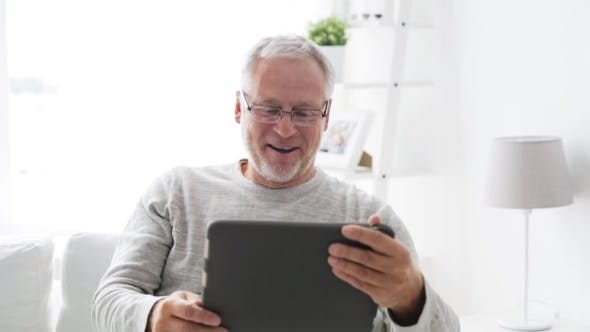 Thumbnail for Senior Man With Video Call On Tablet Pc At Home 12