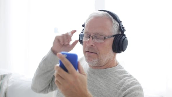 Thumbnail for Happy Senior Man With Smartphone And Headphones 16