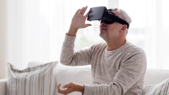 Thumbnail for Old Man In Virtual Reality Headset At Home 80