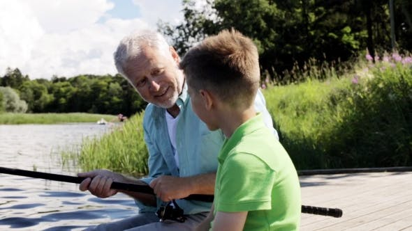 Thumbnail for Grandfather And Grandson Fishing On River Berth 9