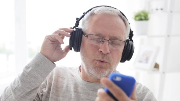 Thumbnail for Happy Senior Man With Smartphone And Headphones 17