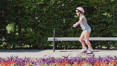 Girl Rides On The Roller Skate.