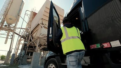 The Truck Driver Gets Into His Truck to Transport the Cargo