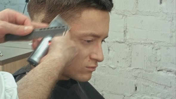 Thumbnail for Portrait Of Young Handsome Man With Perfect Skin And Hair. Cutting Hairs.