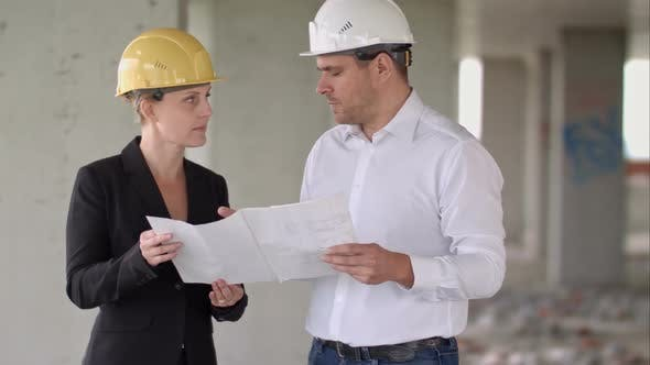 Thumbnail for Two Architects Wearing Protective Helmet Works at Building Site
