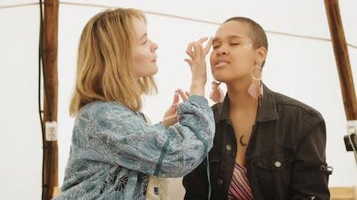 Girlfriends Putting On Glitter Make-up