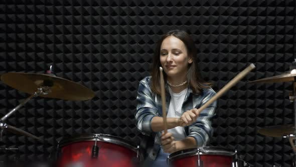 Thumbnail for Woman is playing drums in professional recording studio, Stylish girl is playing drums