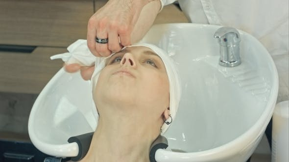 Thumbnail for Woman Relaxing After Washing And Treating Hair In Beauty Salon