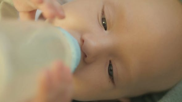 Thumbnail for Sweet Baby Boy Holding Bottle And Drinking Water