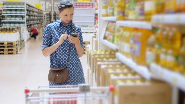 Thumbnail for Young Woman Buys Sunflower Oil In Supermarket
