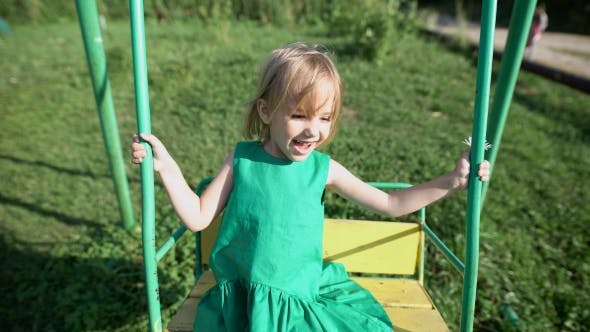 Thumbnail for Adorable Little Girl Having Fun On a Swing Outdoor