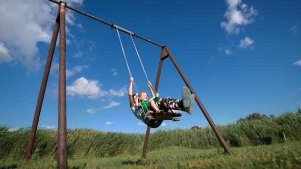Thumbnail for Adorable Little Girl With Her Beautiful Mother Having Fun on a Swing